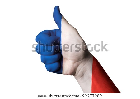 Hand with thumb up gesture colored in france national flag as symbol of excellence, achievement, good, - useful for tourism and touristic advertising
