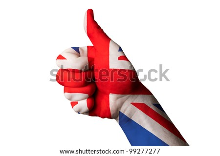 Hand with thumb up gesture colored in great britain national flag as symbol of excellence, achievement, good, - useful for tourism and touristic advertising