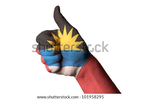 Hand with thumb up gesture in colored antigua barbuda national flag as symbol of excellence, achievement, good, - for touristic advertising, positive political, social management of country
