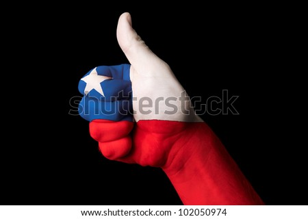Hand with thumb up gesture in colored chile national flag as symbol of excellence, achievement, good, - for tourism and touristic advertising, positive political, social management of country