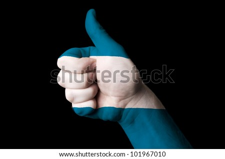 Hand with thumb up gesture in colored el salvador national flag as symbol of excellence, achievement, good, - for tourism and touristic advertising, positive political,  social management of country