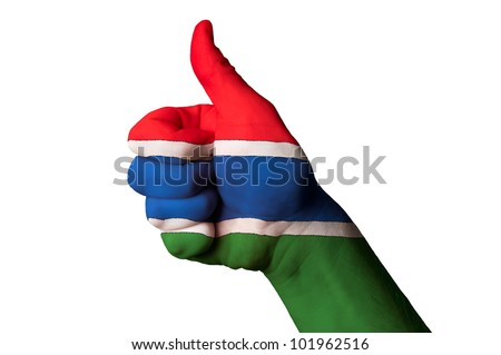 Hand with thumb up gesture in colored gambia national flag as symbol of excellence, achievement, good, - for tourism and touristic advertising, positive political, social management of country