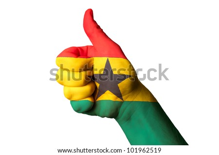 Hand with thumb up gesture in colored ghana national flag as symbol of excellence, achievement, good, - for tourism and touristic advertising, positive political, social management of country