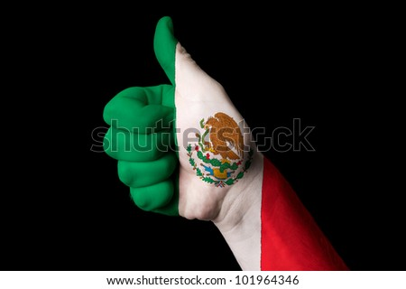 Hand with thumb up gesture in colored mexico national flag as symbol of excellence, achievement, good, - for tourism and touristic advertising, positive political, social management of country