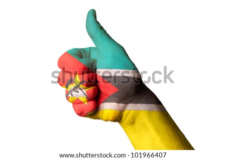 Hand with thumb up gesture in colored mozambique national flag as symbol of excellence, achievement, good, - for tourism and touristic advertising, positive political, social management of country - stock photo