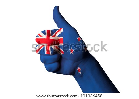Hand with thumb up gesture in colored new zealand national flag as symbol of excellence, achievement, good, - for tourism and touristic advertising, positive political, social management of country