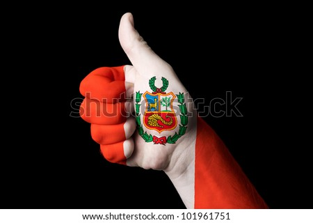 Hand with thumb up gesture in colored peru national flag as symbol of excellence, achievement, good, - for tourism and touristic advertising, positive political, social management of country