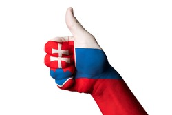 Hand with thumb up gesture in colored slovakia national flag as symbol of excellence, achievement, good, - useful for tourism and touristic advertising