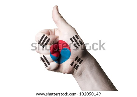 Hand with thumb up gesture in colored south korea national flag as symbol of excellence, achievement, good, - for tourism and touristic advertising, positive political, social management of country