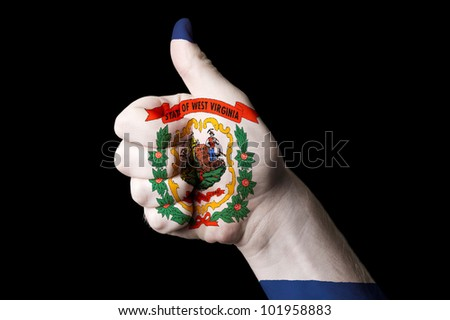 Hand with thumb up gesture in colored west virginia usa state flag as symbol of excellence, achievement, good, - for tourism and touristic advertising, positive political, social management of country - stock photo