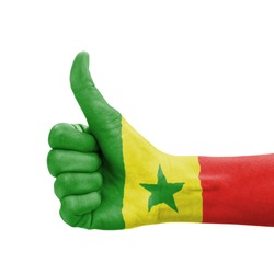 Hand with thumb up, Senegal flag painted as symbol of excellence, achievement, good - isolated on white background