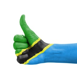 Hand with thumb up, Tanzania flag painted as symbol of excellence, achievement, good - isolated on white background