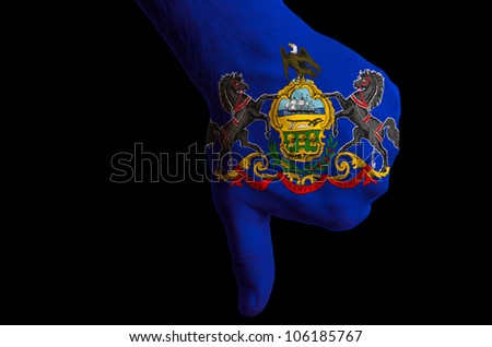 Hand with thumbs down gesture in colored american state of rhode island flag as symbol of negative political, cultural, social management of state