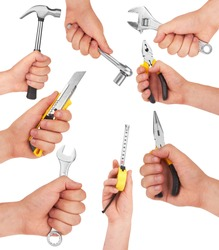 Hand with tools isolated on white background