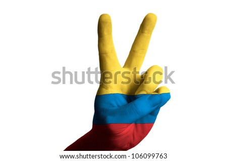 Hand with two finger up gesture in colored colombia national flag as symbol of winning,  - for tourism and touristic advertising, positive political, cultural, social management of country
