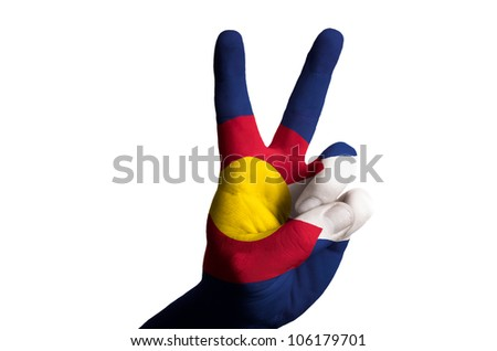 Hand with two finger up gesture in colored colorado state flag as symbol of winning, - for tourism and touristic advertising, positive political, cultural, social management of country