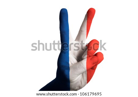 Hand with two finger up gesture in colored france national flag as symbol of winning, - for tourism and touristic advertising, positive political, cultural, social management of country