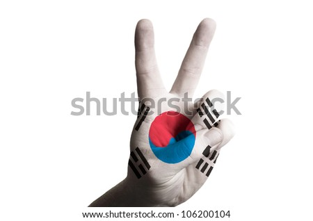 Hand with two finger up gesture in colored south korea national flag as symbol of winning, - for tourism and touristic advertising, positive political, cultural, social management of country