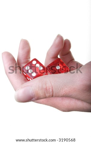 Hand with two red dice isolated on white background