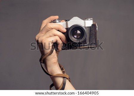 hand with vintage camera