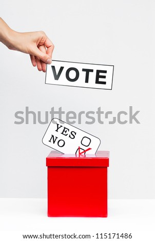 Hand with voting ballot concept