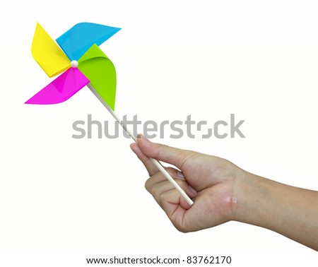 hand with yellow pinwheel on white background