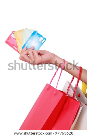 hand woman holding credit card and shopping bags - stock photo