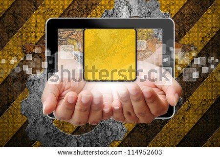 Hand woman pushing out of tablet-pc on industry background