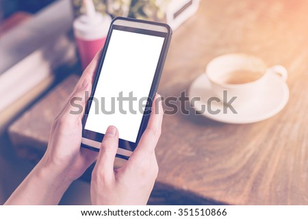 hand woman using smartphone in...