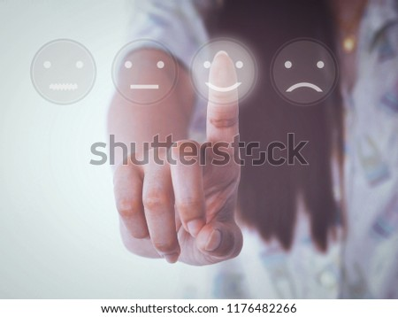 hand women pressing smile buttons on virtual touch screen