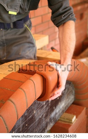 Hand, working hand, working moment, builder, brick, red brick, carved brick, laying of the furnace, construction of the furnace, stove, shift, pecheklad, master, art, artisan,craft, building a barbe.