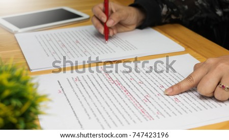 hand working on paper for proofreading