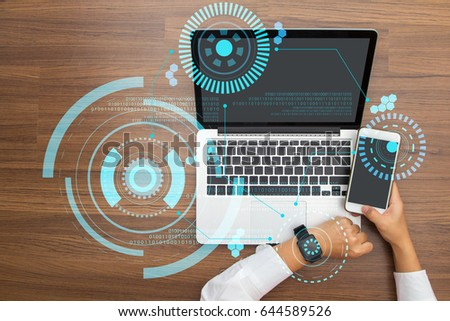 Hand working with Sci fi futuristic user interface modern technology and digital layer effect as business strategy concept, top view