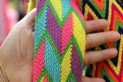 Hand-woven bag line