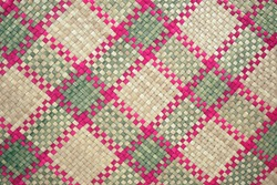 Hand woven mat with graphic patterns