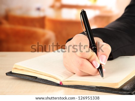 Hand write on notebook, on bright background