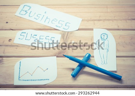 Hand writing a business concept on the wooden board - vintage retro picture style