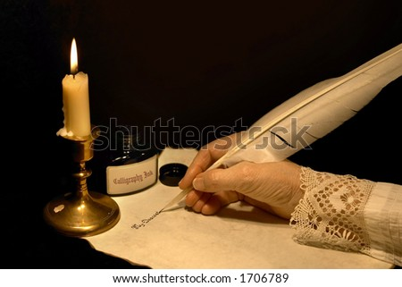 Hand writing a letter with a goose feather
