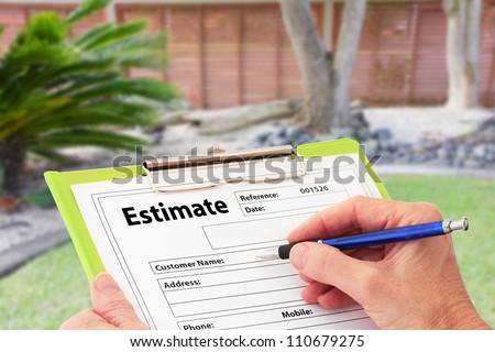 Hand writing an estimate on a clipboard for Garden Maintenance