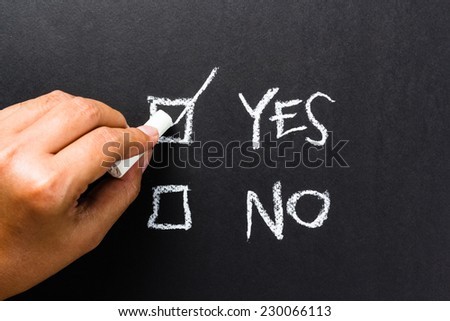 Hand writing correct mark in the box of Yes or No choice
