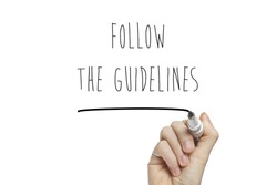 Hand writing follow the guidelines on a white board