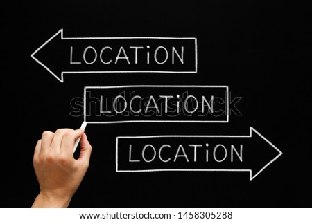 Hand writing Location, Location, Location on three arrows with chalk on blackboard. Real estate concept about the importance of the location. #1458305288