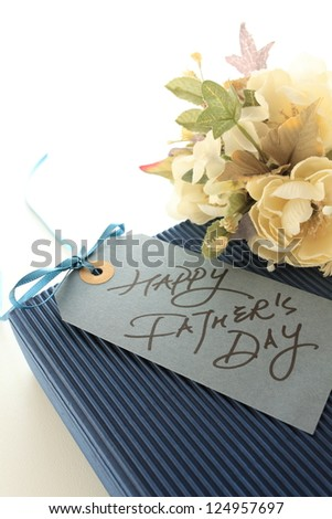 hand writing message card with bouquet and gift for Father's day image