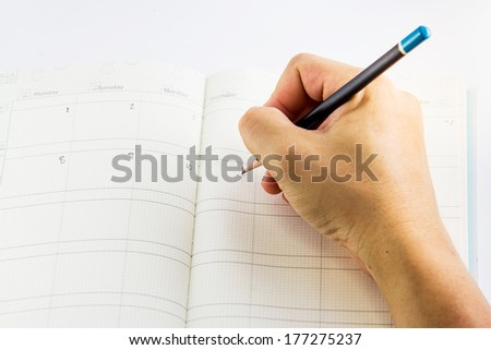 Hand writing on calendar isolation