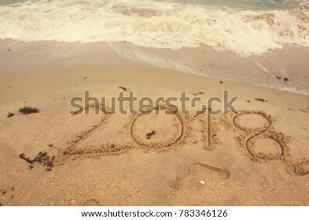 hand writing 2018 on sand #783346126