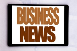 Hand writing text caption inspiration showing Business News. Business concept for Modern Online News written on tablet screen on white background.