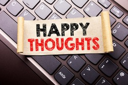 Hand writing text caption inspiration showing Happy Thoughts. Business concept for Happiness Thinking Good written on sticky note paper on dark keyboard background.