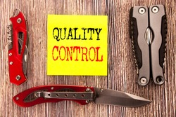 Hand writing text caption inspiration showing Quality Control. Business concept for Improvement Work written on old wooden background with pocket knife with space