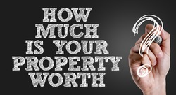 Hand writing the text: How Much Is Your Property Worth?
