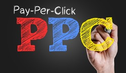 Hand writing the text: Pay-Per-Click